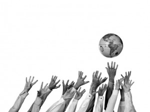 hands-reaching-for-globe